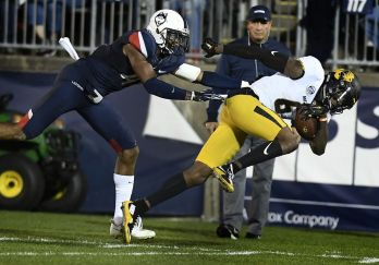 Connecticut defensive back Marshe Terry (41) pushes Missouri wide receiver J'Mon Moore (6) out of bounds during the first half of an NCAA college football game, Saturday, Oct. 28, 2017, in East Hartford, Conn. (AP Photo/Jessica Hill)