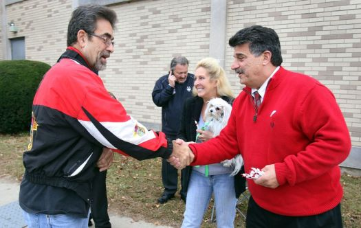 Joseph J. Santopietro Republican candidate for Alderman, right, greets Alan and Nancy Carvalho of Waterbury and her service dog Mary outside Kennedy High School before voting in Waterbury Tuesday. Steven Valenti Republican-American