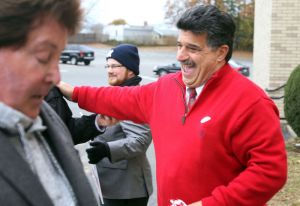 Joe Santopietro Republican candidate for Alderman greets voters outside Kennedy High School before voting in Waterbury Tuesday. Steven Valenti Republican-American