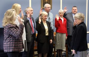Winsted Town Clerk Sheila S. Sedlack, right, swears in the newly elected Board of Selectmen at Town Hall on Wednesday. Steven Valenti Republican-American