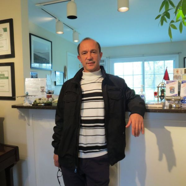 Eddie Cania recently opened the 'Annex' to the Sharon Country Inn, one of his several businesses. Cania, who came from Albania, said he's living the American dream.  Ruth Epstein Republican-American