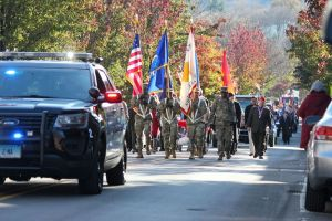 cutline attribution name:Elio Gugliotti Republican-American Naugatuck's Veterans Day parade makes its way up Church Street on Saturday.
