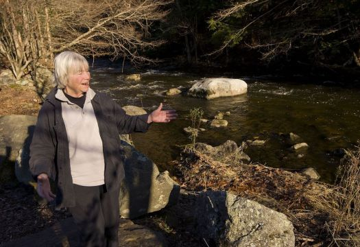 Margaret Miner, head of the Rivers Alliance of Connecticut, talks about the beauty of the Bantam River in Litchfield on Friday. The river has seen heavy flows of sewage this year with little public notice.  Jim Shannon Republican-American