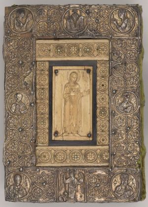 Ivory and silver gilt cover with ivory depicting St. Theodore: top: Etimasia flanked by archangels Raphael and Gabriel; center: Saints Peter and Paul; bottom: donor kneeling before Archangel Michael, flanked by Sts. Mark and Luke. Probably by a Greek artist in Ravenna, 11th century. On: The Sacramentary of Frontale, in Latin, Northeastern Italy, probably Ravenna, ca. 1050. Manuscript on vellum. Gift of the Trustees of the William S. Glazier Collection, 1984