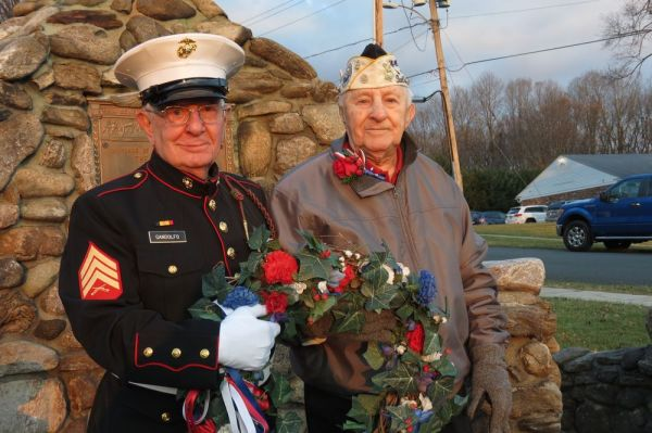 Nicholas Gandolfo, left, a Marine veteran of the Korean War, and Isadore 'Izzy' Tadiello, a Navy veteran who survived Pearl Harbor, place a wreath at the Canaan Doughboy statue on Thursday in recognition of the 76th anniversary of Pearl Harbor. Ruth Epstein Republican-American