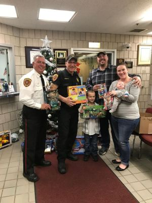 121317ALHO01.jpg WOLCOTT -- Chief Edward Stephens and Officer Bryan Spiotti pose with 8-year-old Gabe Gosgrove, his parents John and Jennifer Cosgrove and baby Cosgrove, at Wolcott Police Department Tuesday. Gabe asked for donations to the police department's Toys for Tots drive instead of birthday presents this year. Contributed photo