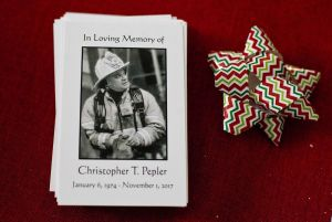 Memorial cards for late Torrington Deputy Fire Chief Christopher Pepler sit on the table of his family's home in Torrington on Thursday. Jim Shannon Republican-American