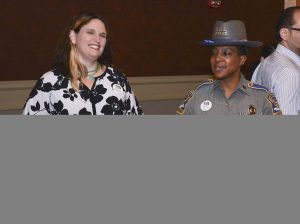 Campership secretary Allison Dederer Romano, left, and Connecticut State Trooper First Class Kelly Grant were among those to help collect donation for the Greater Waterbury Campership Fund during intermission at the Palace Theatre in Waterbury. Jim Shannon Republican-American