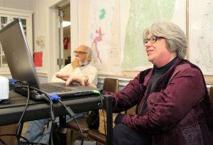 Goshen Public Library Director Lynn Steinmayer reviews the library's website during Monday's open house. Watching is Ernie Barker of Goshen. John McKenna Republican-American