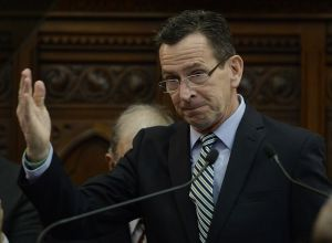 Connecticut Gov. Dannel P. Malloy gestures after delivering the State of the State address during opening session at the state Capitol, Wednesday, Jan. 4, 2017, in Hartford, Conn. (AP Photo/Jessica Hill)