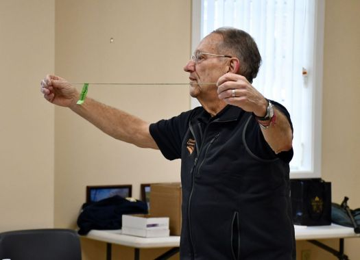 Fred Lowman of Barkhamsted demonstrates the wing span of the common crow during a talk on Sunday at the Barkhamsted Town Garage Community Room. The talk was sponsored by the Friends of American Legion and Peoples State Forests. Kathryn Boughton/Republican-American