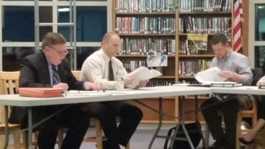 OXFORD --- Jeffrey Mockler, a union representative with the Connecticut Education Association, left, with his client, Great Oak Middle School teacher Christopher D. Cevetillo, at Cevetillo's grievance hearing at Oxford High School Wednesday night. Pictured to the far right is Board of Education member, Stephen Brown. Bill Bittar Republican-American