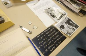 A plaque that hung on the wall of the Northwestern Connecticut YMCA in 1968 and other items removed from a 50-year time capsule were on display Friday in Torrington.