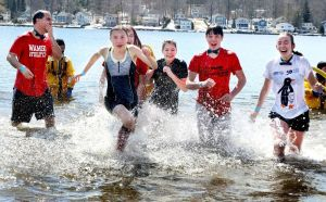 A large group from Wamogo Regional High School in Litchfield takes the plunge during the Penguin Plunge fundraiser for Special Olympics Connecticut at Highland Lake in Winsted on Saturday. Steven Valenti Republican-American