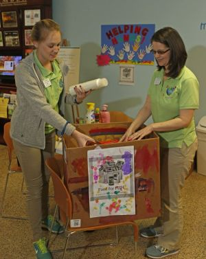 Emily Reiss, left, guest service associate, and Bethany Frasco, operations manager, sort through many donated items during the KidsPlay Children's Museum food drive for FISH on Saturday in Torrington. Michael Kabelka / Republican-American