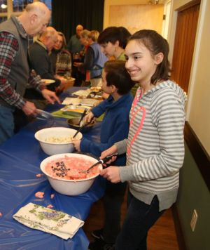Sarah Corey of Goshen is one of the volunteer servers during the Goshen Agricultural Society dinner. John McKenna Republican-American
