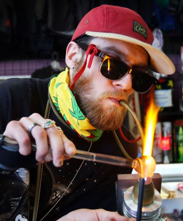 WATERBURY. 20 April 2018-042018SV04-Tanner Barros of Waterbury blows a glass pipe for medical marijuana at Lifestyles on Lakewood Road in Waterbury Friday. Friday was April 20th, 4/20 day known as international cannabis day. Steven Valenti Republican-American