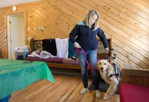 Heather Bring of Westerly, Rhode Island, works with her service dog