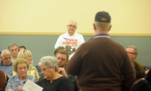 Phil Lent, rear, talks about his uncle, David Lent, a Marine who received the Purple Heart for his actions in World War II, during a gathering at Torrington City Hall on Thursday. Bruno Matarazzo Jr.
