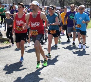 Litchfield Track Club runners Sean Clinkscales of Torrington, left, and Mike Main of Litchfield are the first runners off the starting line in the Shane Kinsella Memorial Road Race in Goshen on Saturday. John McKenna Republican-American