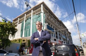 On April 12, 2018, after two years of construction, developer Carlos Rosso stands in front of Wynwood 25, a microunit building that is scheduled to top off later this summer and will be comprised entirely of microunit apartments. (C.M. Guerrero/Miami Herald/TNS)