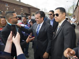 Ricardo Rossello, Governor of Puerto Rico, center, is greeted my members of the Puerto Rican community including Ruben Rodriguez, left, and Jose L. Morales, right, during his visit to the Bread of Heaven Bakery in Waterbury on Saturday. Jim Shannon Republican-American