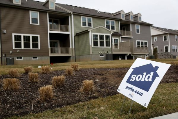 In this Feb. 26 photo, sold signs are displayed in front of a new development in Woodcliff Lake, N.J. (AP Photo/Seth Wenig, File)