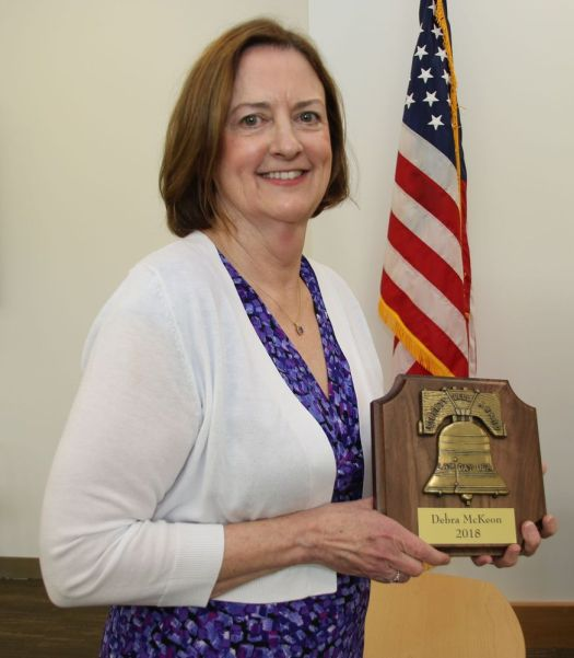 Torrington Superior Court administrative clerk Debra McKeon holds the Liberty Bell Award she received during Law Day at the courthouse on Friday. John McKenna Republican-American
