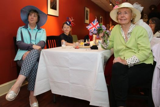 LITCHFIELD, CT - 19 May 2018 - 051918JM01 - Watching the royal wedding at the Village Restaurant in Litchfield on Saturday are, from left, Jennifer Lent of Torrington, Harper Hawley, 7, of Goshen, and Marsha Thompson of Thomaston. John McKenna Photo