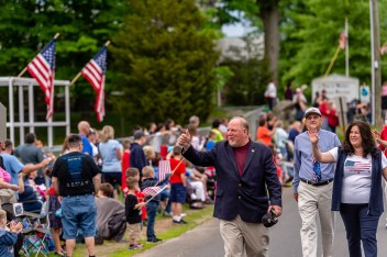 WOLCOTT, CT. 28 May 2018-052818BS352 - Wolcott Mayor Thomas G. Dunn along with his wife Lisa wave to those gathered along the streets of the 2018 Wolcott Memorial Day Parade on Monday evening. Bill Shettle Republican-American