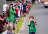 WOLCOTT, CT. 28 May 2018-052818BS352 - A little girl covers her ears from the loud sounds of the sirens and horns, from the Wolcott Volunteer Firefighters Fire Engines in the 2018 Wolcott Memorial Day Parade on Monday evening. Bill Shettle Republican-American
