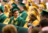 WATERBURY, CT-060218JS06-- Holy Cross graduate William Gugelielmo, left, chats with fellow graduates during graduation ceremonies Sunday at Holy Cross High School. Gugelielmo was awarded the Dad's Club Service Award during the ceremony. Jim Shannon Republican American