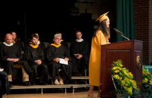 WATERBURY, CT-060218JS07-- Holy Cross Valedictorian Wen Ting Zheng, gives her farewell address during graduation ceremonies Sunday at Holy Cross High School. Jim Shannon Republican American