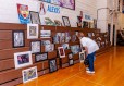 WOODBURY, CT. 07 June 2018-060718BS570 - Woodbury resident Joanne Milo, looks at the artwork on display by the students of region 14 at Nonnewaug High School on Thursday afternoon. Bill Shettle Republican-American