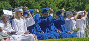 Shepaug Valley School graduates turn their tassels during commencement on Saturday morning in Washington, Conn. Michael Kabelka / Republican-American