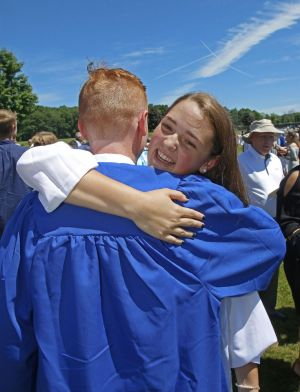 Shepaug Valley School graduate Olivia Moore celebrates with classmate Alan Stinson after commencement on Saturday in Washington, Conn. Michael Kabelka / Republican-American