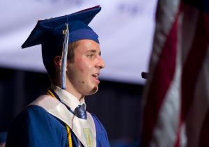 Lewis Mills valedictorian Kyle Kadziolka gives his address Thursday at the Warner Theatre in Torrington. Jim Shannon Republican American