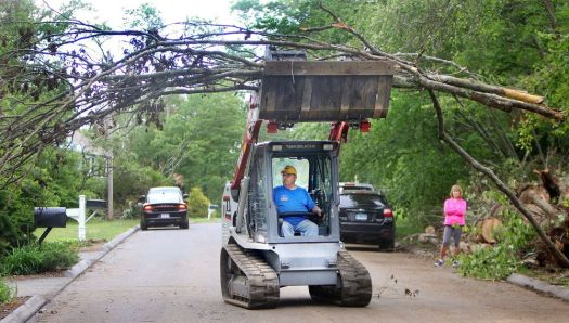 SOUTHBURY CT. 05 June 2018-060518SV02- Jimmy Brake moves large branches to the side of the road for removal on Sleepy Hill Road in Southbury Tuesday. Brake is a volunteer with Southern Baptist Convention Disaster Relief of Tennessee. The organization was in the area helping residents with storm cleanup.  Steven Valenti Republican-American