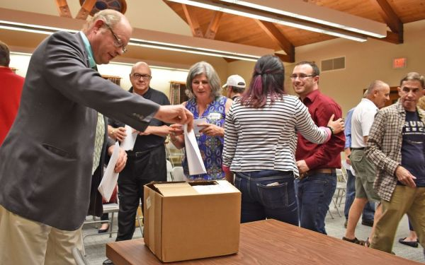 Republicans vote in a straw poll for the three GOP candidates for the 5th Congressional District on Thursday evening at Kent Town Hall. Ruby Corby O'Neill won. Lynn Mellis Worthington Republican-American