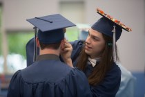 Josh Krivensky adjusted a friends hat before graduating from Oxford High School on Wednesday, June 20 in Oxford, Conn. Christopher Burns Republican/American