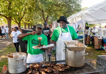 WATERBURY, CT. 30 June 2018-063018BS423 - Vinnie Smith, left, and Robert Riley of Berties West Indian American Restaurant of Waterbury stand over the hot grill preparing meals for hungry customers during the Fourth Annual Jerk Festival featuring authentic food from the Caribbean at Library Park in Waterbury, CT on Saturday afternoon. Bill Shettle Republican-American