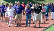 """SOUTHBURY, CT-070818JS13-- Family, friends and supporters make their way around the track during Sunday's """"Walk for Wade"""" event held at Pomperaug High School in Southbury. Wade Prajer, a star athlete at Pomperaug and a criminal justice major at University of New Haven, took his own life on June 3 at the age of 22. The walk was held to honor his life and to help prevent future tragedies. Proceeds from the event will benefit the Alex Archie Foundation. Jim Shannon Republican American"""