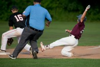 Naugatuck's Steven Marinaro (24) slides safely into third for a triple as Oakville's Ryan Loiselle (16) covers the throw during their Zone 5 American Legion game Tuesday at the Taft School in Watertown. Jim Shannon Republican American