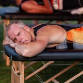 Triathlete Arthur Boyko of NY gets some deep tissue massage after competing in the 32nd annual Pat Griskus Sprint Triatalon at Quassy Amusement Park in Middlebury, CT on Wednesday evening. Bill Shettle Republican-American