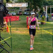 Karen Pompay of NY crosses the finish line as the overall winner of the womens division during the the 32nd annual Pat Griskus Sprint Triathalon at Quassy Amusement Park in Middlebury, CT on Wednesday evening. Bill Shettle Republican-American