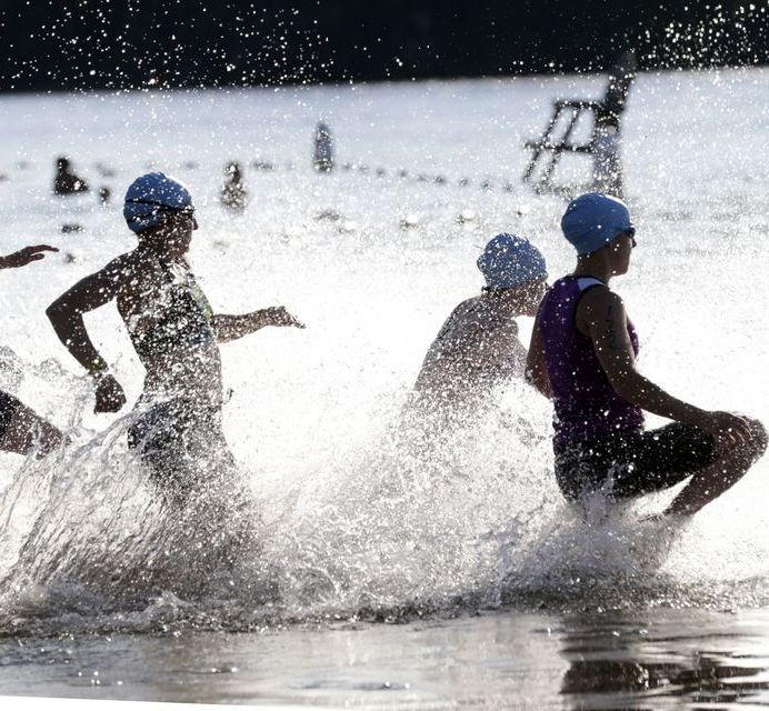 Middlebury, CT- 05 July 2017-070517CM04- Competitors run into the water during the annual Pat Griskus Sprint Triathlon at Lake Quassy on Wednesday. Christopher Massa Republican-American