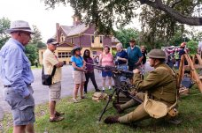 TORRINGTON, CT. 28 July 2018-072818BS12 - WW II re-enactor Colt Falletti of Ellington talks to a group of people while sitting with the 8mm Lebel machine gun during the the WW I Living History Day at the Torrington Historical Society in Torrington, CT on Saturday afternoon. Bill Shettle Republican-American