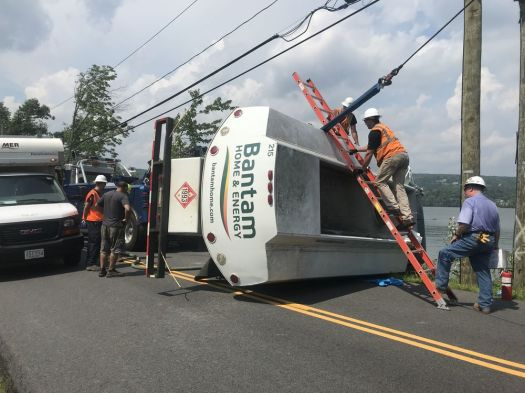A Bantam Home & Energy truck carrying about 1,500 gallons of home heating oil rolled over for unknown reasons on West Shore Road along the banks of Lake Waramaug in Washington, Conn. The driver of the truck suffered minor injuries. Jacqueline Stoughton/Republican-American