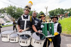 WATERBURY, CT. 20 August 2018-082018 - Berkeley Knight drummer Darren Richards, Drill Master Mike Tripp, Berkeley Drill team members Carrizma Gore and Tahanya Hillard stand with the World Championship Trophy that they were awarded with in Jacksonville FL ,in the parking lot of the Berkeley City Recreation Center in Waterbury on Monday evening. Bill Shettle Republican-American