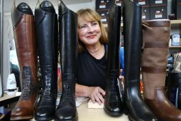 Carol DiCarlo, owner of the new Cheshire Equestrian Center prepares riding boots for sale in her shop in Cheshire Wednesday.Steven Valenti/Republican-American